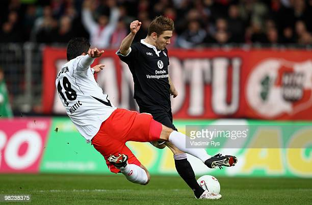 Erik Jendrisek of Kaiserslautern shoots to score his team's first goal as Marinko Miletic of Oberhausen tries to block the shot during the Second...
