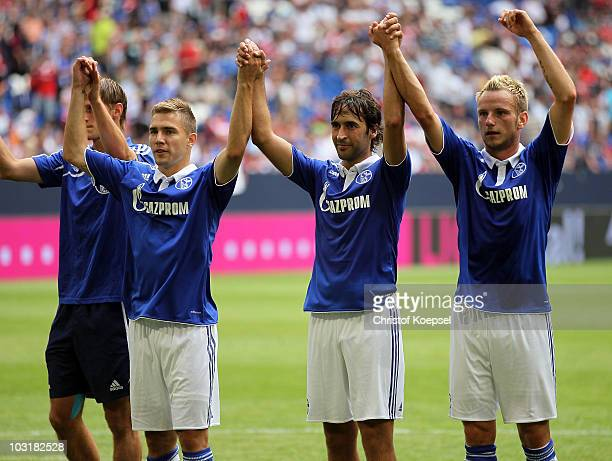 Erik Jendrisek Raul Gonzalez and Ivan Rakitic of Schalke celebrate the 21 victory during the LIGA total Cup 2010 match between FC Schalke 04 and...