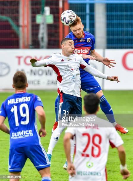 Erik Jirka of Gornik and Mikkel Kirkeskov of Piast compete for the ball during the PKO Ekstraklasa match between Gornika Zabrze and Piast Gliwice at...