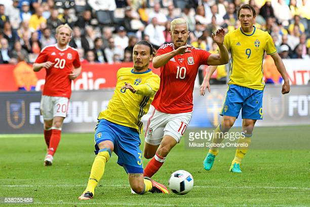Erik Johansson of Sweden and Aaron Ramsey of Wales during the international friendly between Sweden and Wales at Friends Arena on June 5 2016 in...
