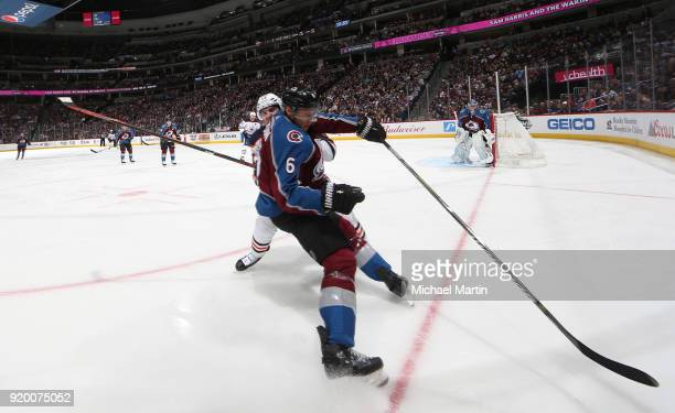 Erik Johnson of the Colorado Avalanche battles against Michael Cammalleri of the Edmonton Oilers at the Pepsi Center on February 18 2018 in Denver...