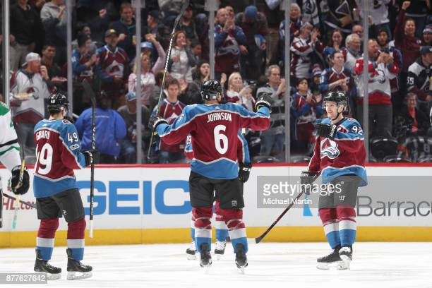 Erik Johnson of the Colorado Avalanche celebrates a goal against the Dallas Stars with teammates Gabriel Landeskog and Samuel Girard at the Pepsi...