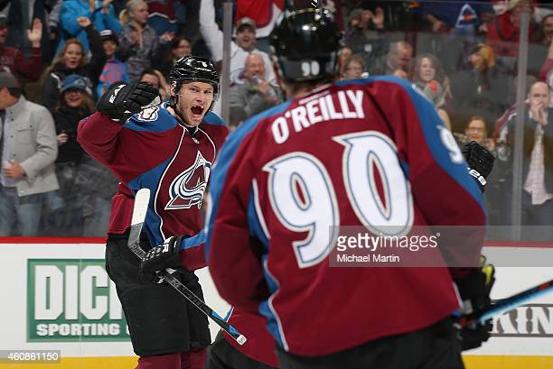 Erik Johnson of the Colorado Avalanche celebrates a goal with Ryan O'Reilly against the Chicago Blackhawks at the Pepsi Center on December 27 2014 in...