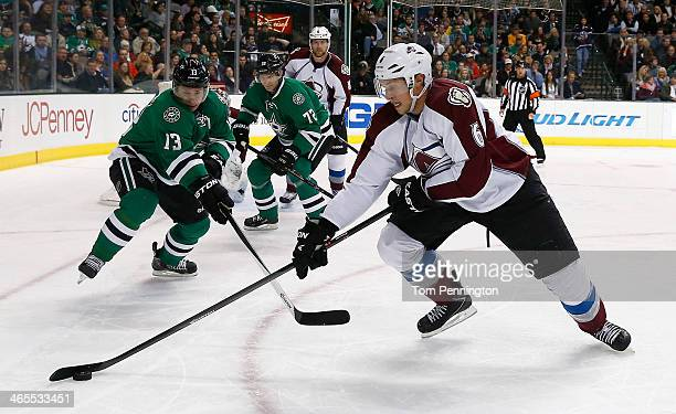 Erik Johnson of the Colorado Avalanche controls the puck against Ray Whitney of the Dallas Stars Erik Cole of the Dallas Stars in the first period at...