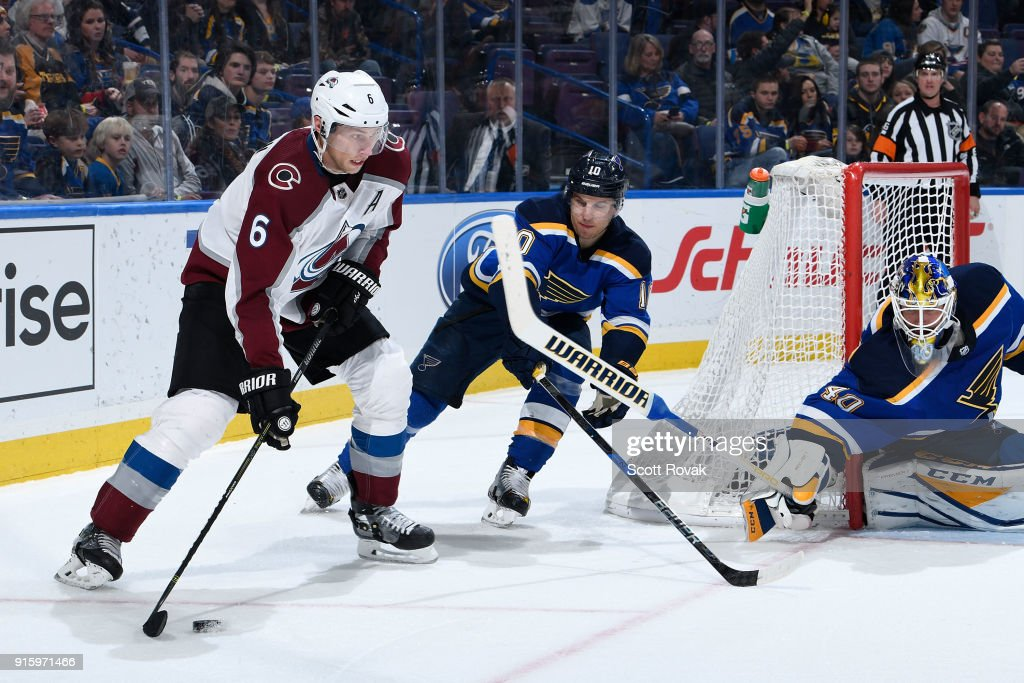 Erik Johnson #6 of the Colorado Avalanche looks to pass as Brayden Schenn #10 of the St. Louis Blues and Carter Hutton #40 of the St. Louis Blues defend the net at Scottrade Center on February 8, 2018 in St. Louis, Missouri.