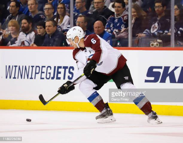 Erik Johnson of the Colorado Avalanche plays the puck at the point during first period action against the Winnipeg Jets at the Bell MTS Place on...