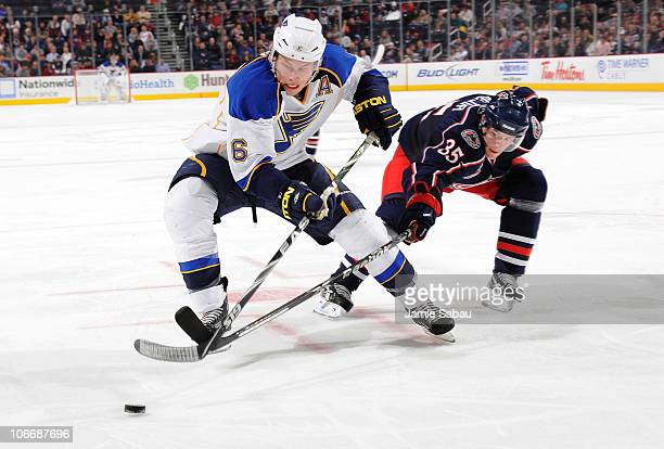 Erik Johnson of the St Louis Blues and Jan Hejda of the Columbus Blue Jackets battle for control of the puck during the third period on November 10...