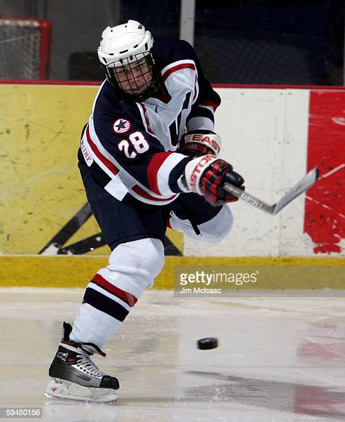 Erik Johnson of the United States clears the puck against Sweden during USA Hockey's Junior Men's Summer Challenge on August 12, 2005 at the Olympic...