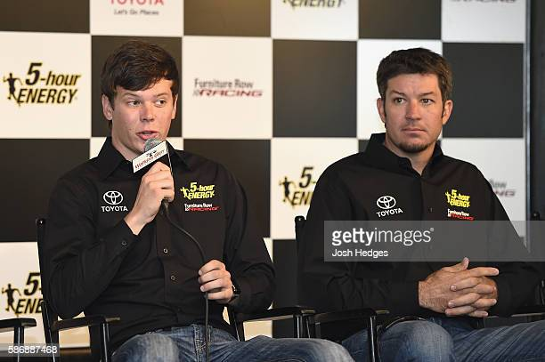 Erik Jones and Martin Truex Jr driver of the Furniture Row Toyota speak to the media after announcing Jones will drive the 5 hour Energy Toyota for...