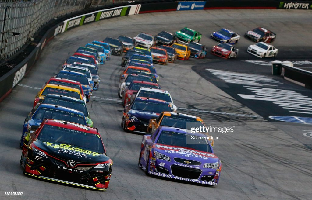 Erik Jones, driver of the #77 5-hour ENERGY Extra Strength Toyota, and Kyle Larson, driver of the #42 Huggies Little Movers Chevrolet, lead the field to start during the Monster Energy NASCAR Cup Series Bass Pro Shops NRA Night Race at Bristol Motor Speedway on August 19, 2017 in Bristol, Tennessee.