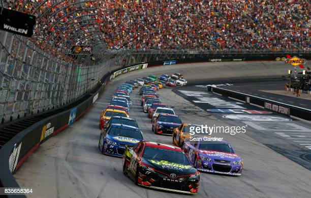 Erik Jones driver of the 5hour ENERGY Extra Strength Toyota and Kyle Larson driver of the Huggies Little Movers Chevrolet lead the field to start...