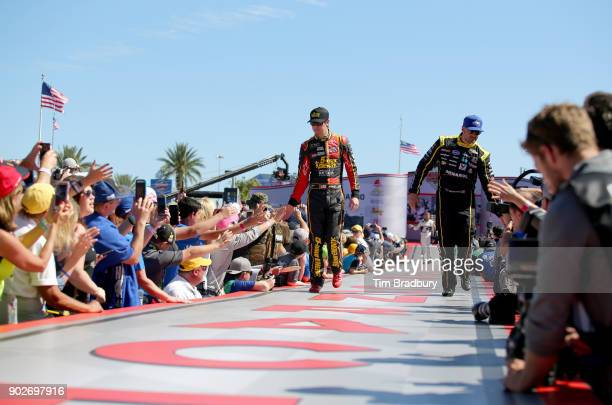 Erik Jones driver of the 5hour Energy Extra Strength Toyota and Paul Menard driver of the Menards/Peak Chevrolet are introduced onstage during the...