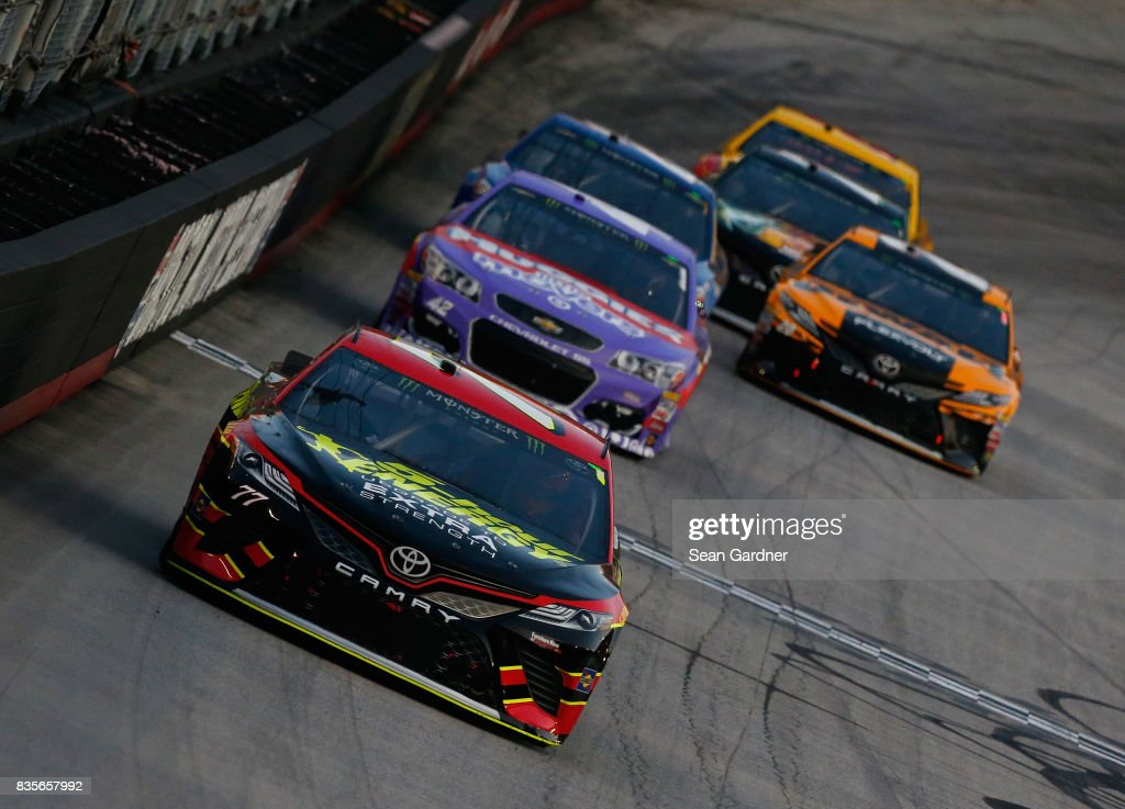 Erik Jones, driver of the #77 5-hour ENERGY Extra Strength Toyota, leads a pack of cars during the Monster Energy NASCAR Cup Series Bass Pro Shops NRA Night Race at Bristol Motor Speedway on August 19, 2017 in Bristol, Tennessee.