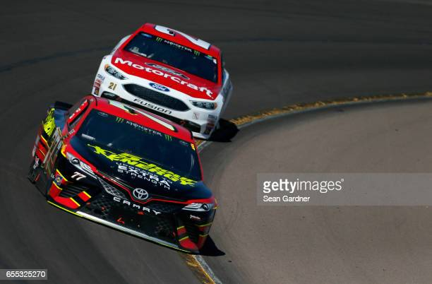 Erik Jones driver of the 5hour Energy Extra Strength Toyota leads Ryan Blaney driver of the Motorcraft/Quick Lane Tire Auto Center Ford during the...