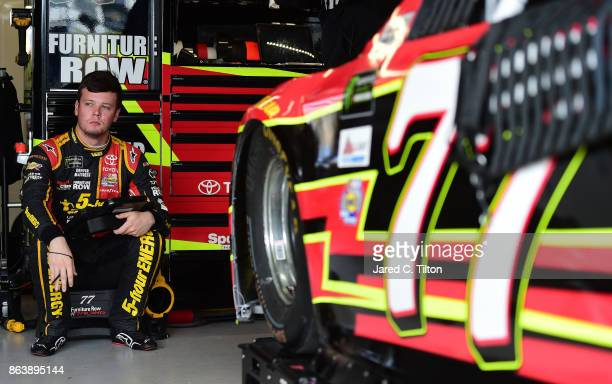 Erik Jones driver of the 5hour ENERGY Extra Strength Toyota looks on from the garage during practice for the Monster Energy NASCAR Cup Series...