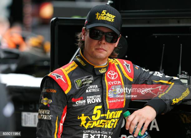 Erik Jones driver of the 5hour ENERGY Extra Strength Toyota stands by his car during practice for the Bass Pro Shops NRA Night Race at Bristol Motor...