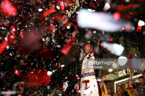 Erik Jones driver of the buyatoyotacom Toyota celebrates in Victory Lane after winning the Monster Energy NASCAR Cup Series Coke Zero Sugar 400 at...
