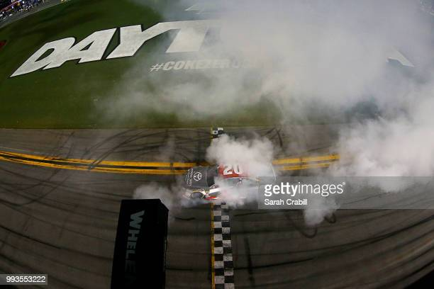 Erik Jones driver of the buyatoyotacom Toyota celebrates with a burnout after winning the Monster Energy NASCAR Cup Series Coke Zero Sugar 400 at...