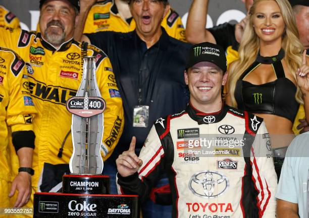 Erik Jones driver of the buyatoyotacom Toyota celebrates with the trophy in Victory Lane after winning the Monster Energy NASCAR Cup Series Coke Zero...