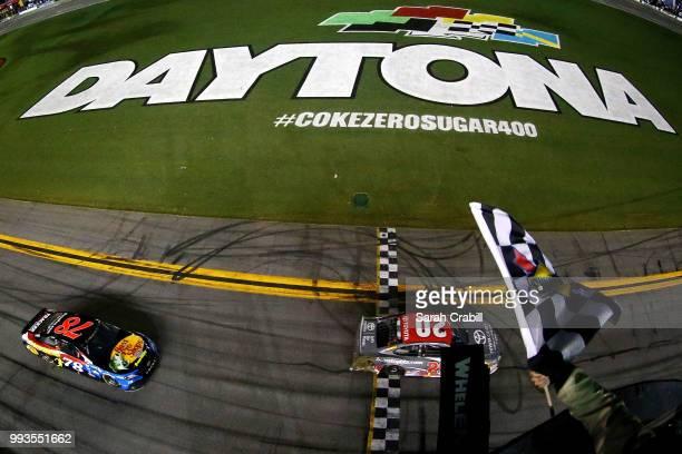 Erik Jones driver of the buyatoyotacom Toyota takes the checkered flag to win the Monster Energy NASCAR Cup Series Coke Zero Sugar 400 at Daytona...