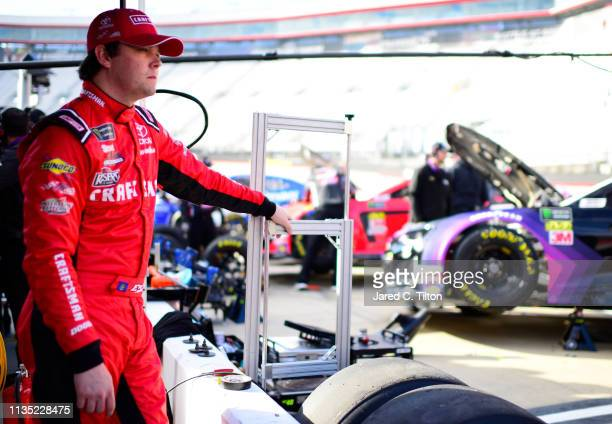 Erik Jones driver of the CRAFTSMAN Racing for a Miracle Toyota stands in the garage area during practice for the Monster Energy NASCAR Cup Series...