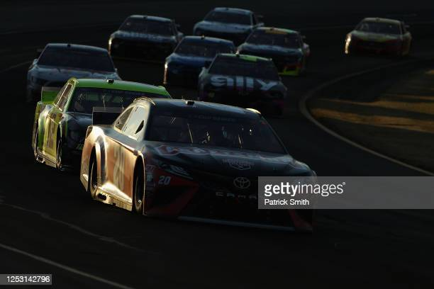 Erik Jones, driver of the Craftsman Toyota, leads a group of cars during the NASCAR Cup Series Pocono 350 at Pocono Raceway on June 28, 2020 in Long...