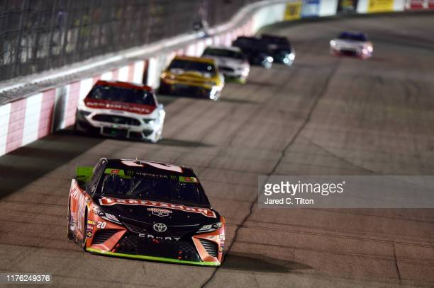 Erik Jones driver of the Craftsman Toyota leads a pack of cars during the Monster Energy NASCAR Cup Series Federated Auto Parts 400 at Richmond...