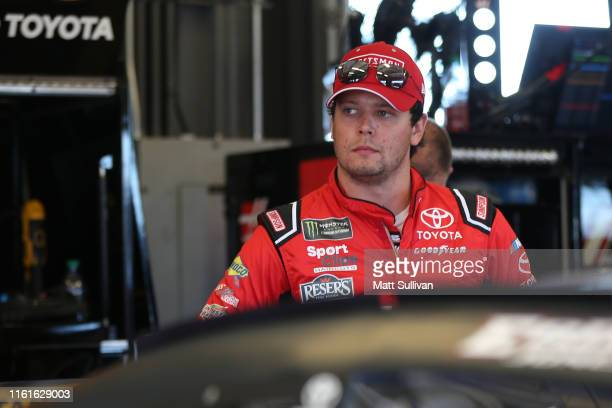 Erik Jones driver of the Craftsman Toyota stands by his car during practice for the Monster Energy NASCAR Cup Series Quaker State 400 Presented by...