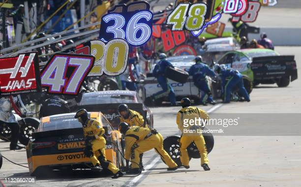 Erik Jones driver of the DeWalt Toyota pits during the Monster Energy NASCAR Cup Series STP 500 at Martinsville Speedway on March 24 2019 in...