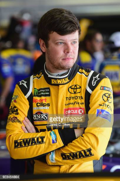 Erik Jones driver of the DEWALT Toyota stands in the garage area during practice for the Monster Energy NASCAR Cup Series Folds of Honor QuikTrip 500...