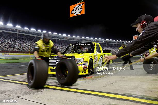 Erik Jones driver of the Dollar General Toyota pits during the NASCAR Camping World Truck Series North Carolina Education Lottery 200 at Charlotte...