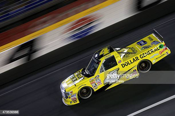 Erik Jones driver of the Dollar General Toyota races during the NASCAR Camping World Truck Series North Carolina Education Lottery 200 at Charlotte...