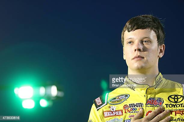 Erik Jones driver of the Dollar General Toyota stands on the grid prior to the NASCAR Camping World Truck Series North Carolina Education Lottery 200...