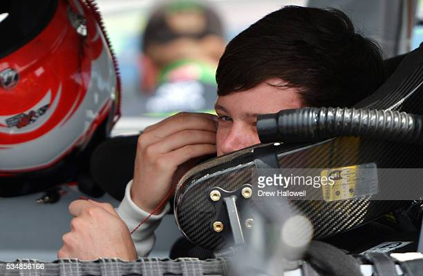 Erik Jones driver of the GameStop Toyota sits in his car during qualifying for the NASCAR XFINITY Series Hisense 300 at Charlotte Motor Speedway on...
