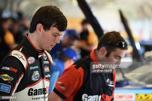 Erik Jones driver of the GameStop Toyota stands in the garage during practice for the NASCAR XFINITY Series VysitMyrtleBeachcom 300 at Kentucky...