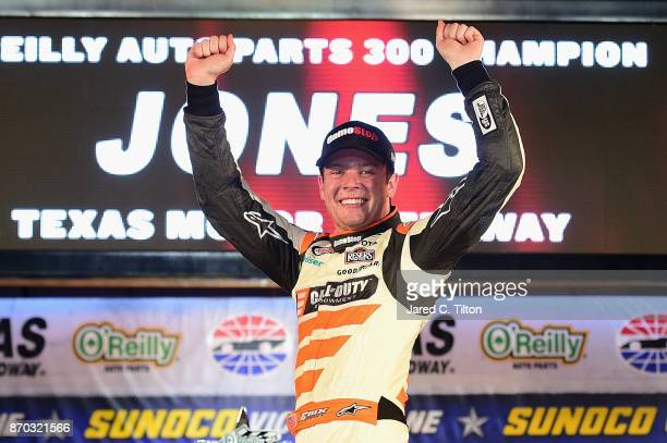 Erik Jones driver of the GameStop/Call of Duty WWII Toyota celebrates in Victory Lane after winning the NASCAR XFINITY Series O'Reilly Auto Parts 300...