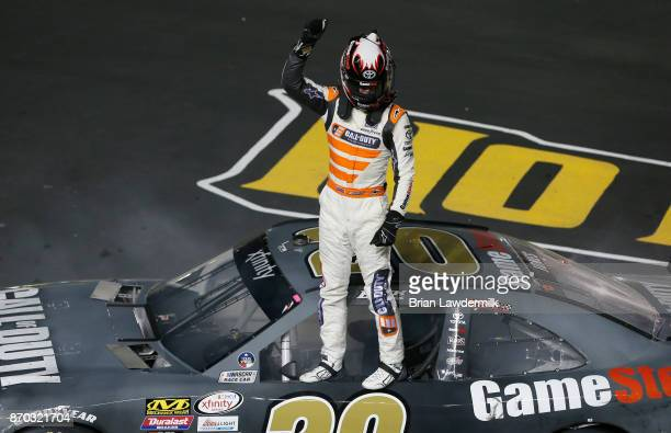 Erik Jones driver of the GameStop/Call of Duty WWII Toyota celebrates after winning the NASCAR XFINITY Series O'Reilly Auto Parts 300 at Texas Motor...