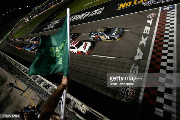 Erik Jones driver of the GameStop/Call of Duty WWII Toyota leads Cole Custer driver of the Haas Automation Ford to the green flag to start the NASCAR...