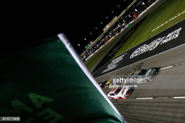 Erik Jones driver of the GameStop/Call of Duty WWII Toyota leads Cole Custer driver of the Haas Automation Ford and Matt Tifft driver of the Surface...