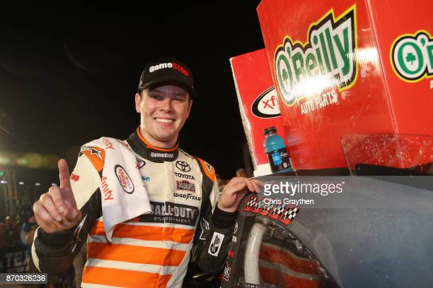 Erik Jones driver of the GameStop/Call of Duty WWII Toyota poses with the winner's decal in Victory Lane after winning the NASCAR XFINITY Series...