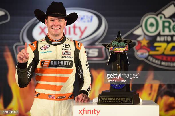 Erik Jones driver of the GameStop/Call of Duty WWII Toyota poses with the trophy in Victory Lane after winning the NASCAR XFINITY Series O'Reilly...