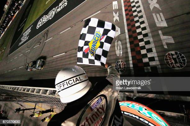 Erik Jones driver of the GameStop/Call of Duty WWII Toyota takes the checkered flag to win the NASCAR XFINITY Series O'Reilly Auto Parts 300 at Texas...