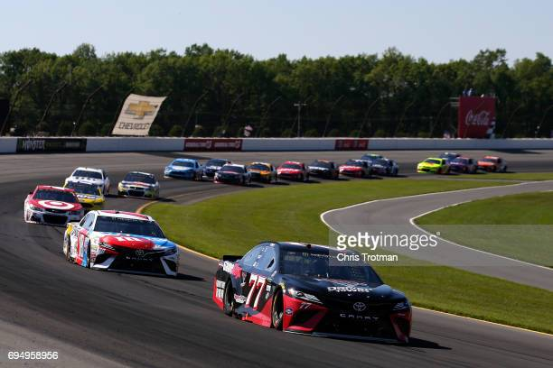 Erik Jones driver of the GameStop/Cars 3 Driven to Win Toyota leads a pack of cars during the Monster Energy NASCAR Cup Series Axalta presents the...