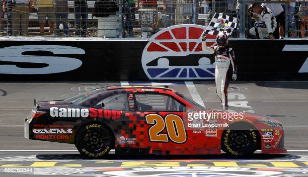 Erik Jones driver of the GameStop/GAEMS Toyota celebrates winning the NASCAR XFINITY Series My Bariatric Solutions 300 at Texas Motor Speedway on...