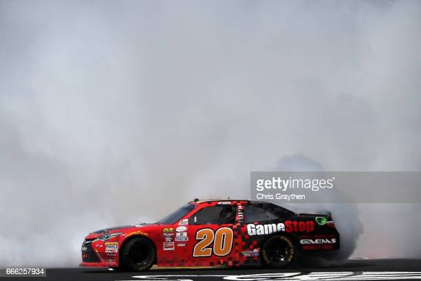 Erik Jones driver of the GameStop/GAEMS Toyota celebrates with a burnout after winning the NASCAR XFINITY Series My Bariatric Solutions 300 at Texas...