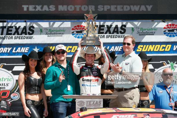 Erik Jones driver of the GameStop/GAEMS Toyota celebrates with the trophy in Victory Lane after winning the NASCAR XFINITY Series My Bariatric...