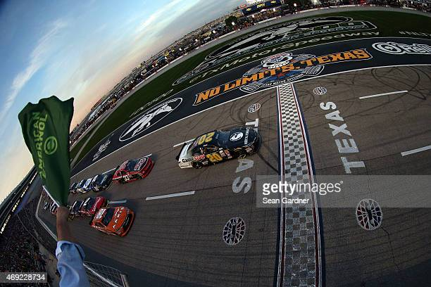 Erik Jones driver of the GameStop/Mortal Kombat X Toyota and Daniel Suarez driver of the ARRIS Toyota lead the field to the green flag for the...