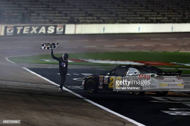 Erik Jones driver of the GameStop/Mortal Kombat X Toyota celebrates with the checkered flag after winning the NASCAR XFINITY Series O'Reilly Auto...