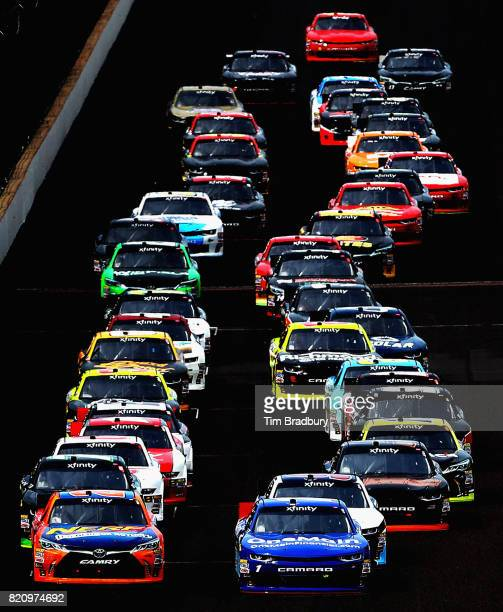 Erik Jones driver of the GameStop/Nerf Toyota and Elliott Sadler driver of the OneMain Financial Chevrolet lead the field at the start of the NASCAR...