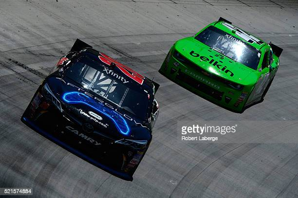 Erik Jones driver of the Gamestop/Performance Designed Products Toyota leads Kyle Larson driver of the BELKIN Chevrolet during the NASCAR XFINITY...